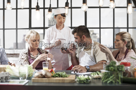 group of people taking cooking course