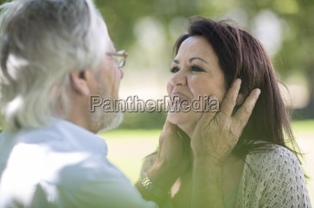 tender senior couple outdoors