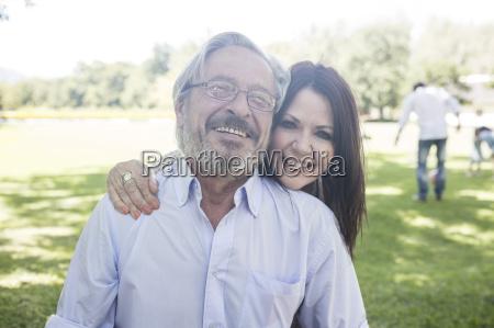 portrait of smiling senior couple outdoors