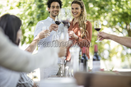 couple raising a toast together with