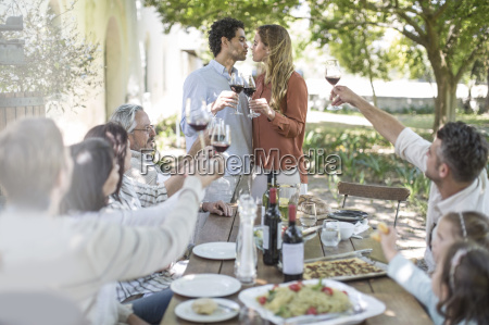 couple kissing during lunch in garden