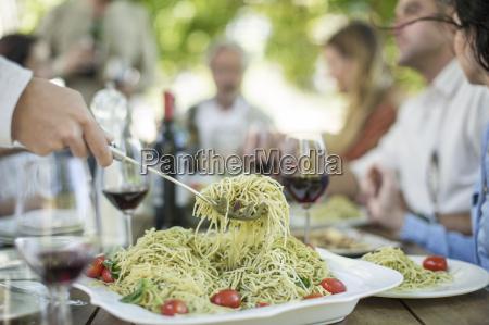 eating spaghetti for lunch in garden
