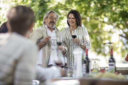 senior couple raising a toast