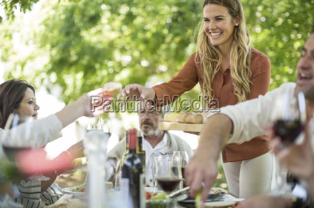 smiling woman at family lunch in
