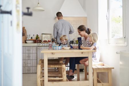 kids at kitchen table with mum