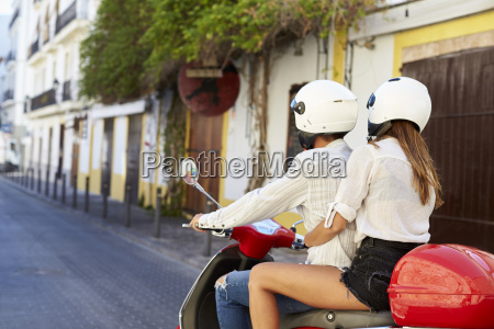 young adult couple on a motor