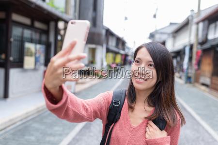 woman taking selfie image in nagahama