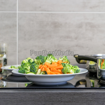 plate with raw broccoli and carrots