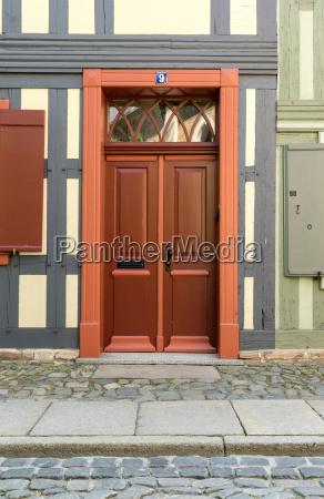 red wooden door of a half