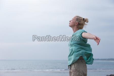 free woman enjoying windy weather on