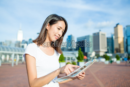 woman looking on city map in