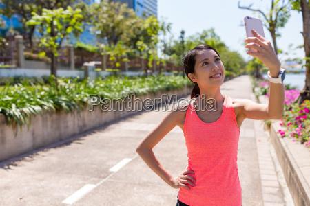 sport woman taking selfie by mobile