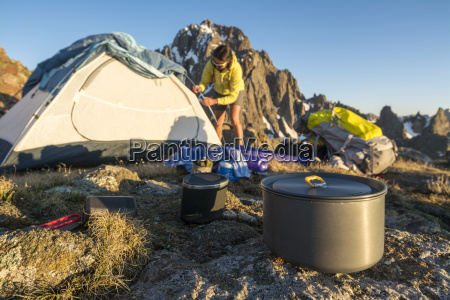 a woman preparing for camping on
