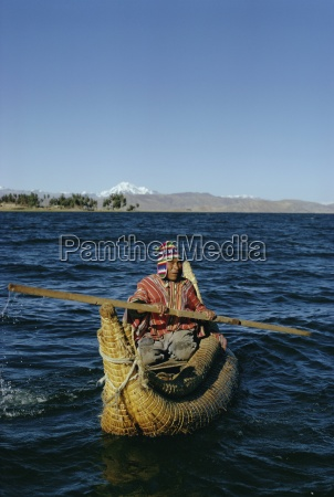 aymara indian in a reed boat