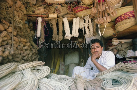 stallholder selling rope twine and baskets