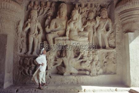 rock cut panel depicting the hindu
