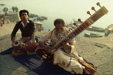 sitar and tabla player beside the