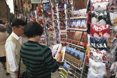 tourists choosing book warsaw poland europe