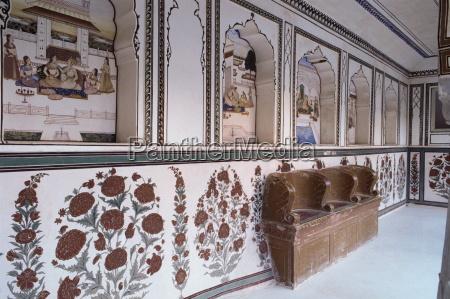 narrow painted veranda with deep niches