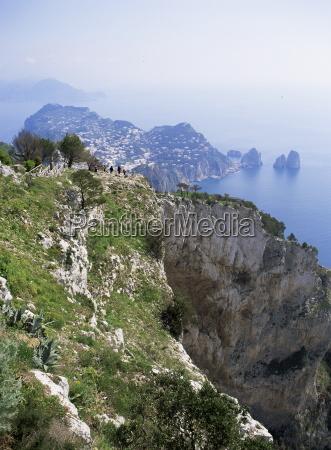 distant capri village and faraglioni rocks