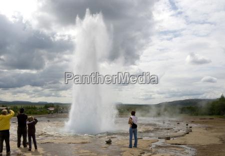 strokkur geyser in eruption geysir geothermal