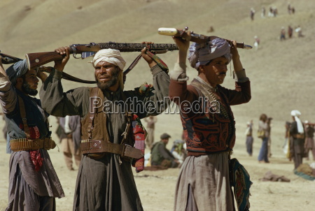 pushtoon tribesmen dancing at jeshan celebration