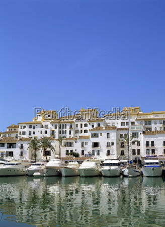 boats in the harbour and apartment