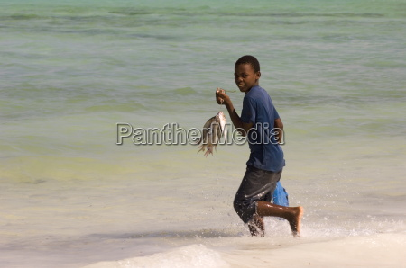a boy running in the sea