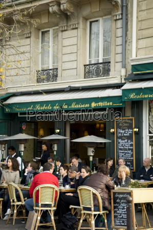 people sitting outside a cafe on