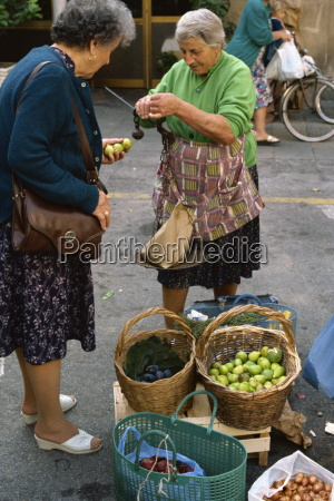 woman selling figs with an old