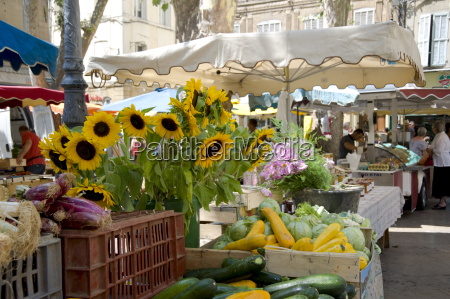 sunflowers and vegetables on sale in