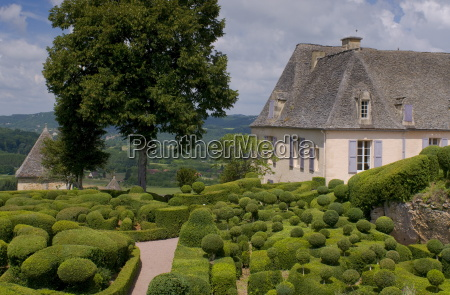 elaborate topiary surrounding the chateau at