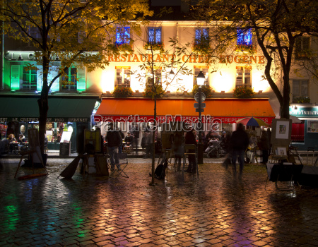 restaurants and cafes lit at night
