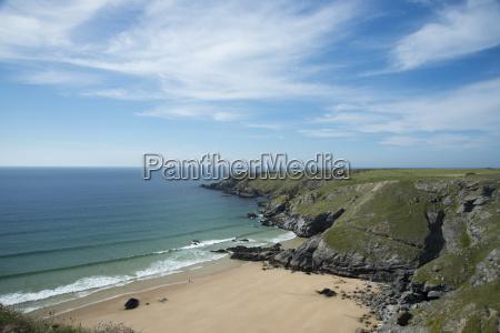 porthcothan beach and surrounding cliffs cornwall