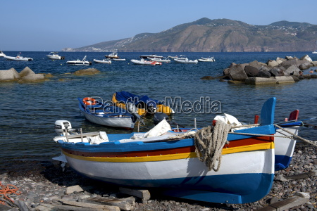 colourful wooden fishing boats in lingua