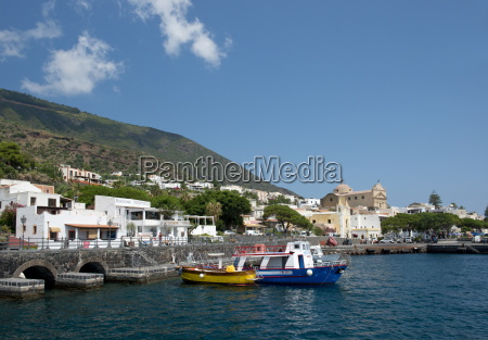 colourful wooden boats in santa marina