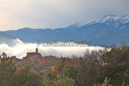 view of morning mist and arboussols