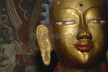 detail of buddha statue at alchi