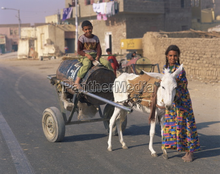 portrait of children fetching water on