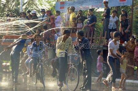 crowds being sprayed with water during