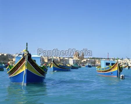 painted boats in the harbour at