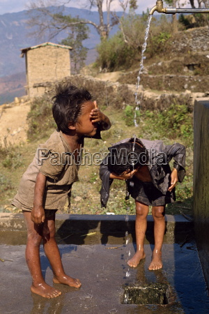 portrait of two children washing at