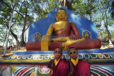 thuptens twin monks wearing sunglasses in