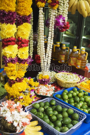stall selling fruit and flower garlands