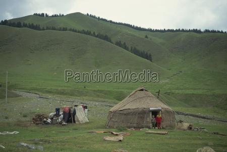 children in front of a yurt