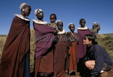 tourist with masai people ngorongoro crater