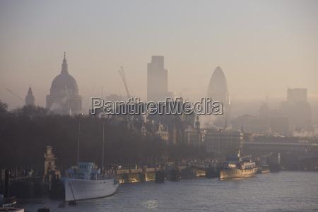 early morning fog hangs over st