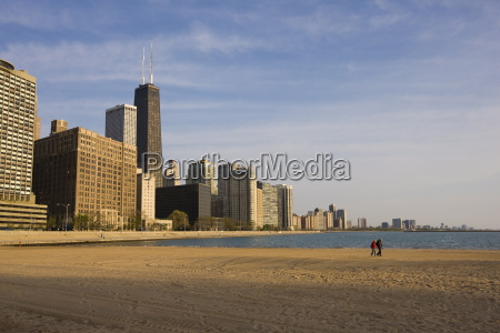 walkers on ohio street beach with