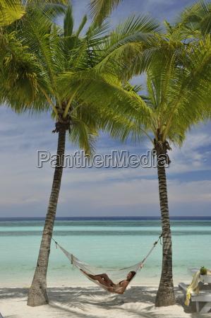 girl on a hammock bohol beach