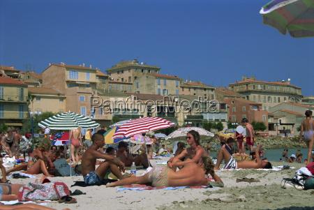 people on the beach ile rousse